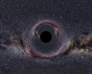 Simulated view of a black hole in front of the Milky Way, or a picture from the Milky Way's annoying warped picture folder on Facebook.