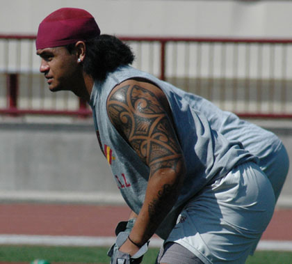Rey, in the foreground with Samoan Tribal Tatoo's on arms
