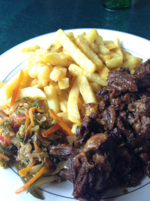 Typical chips, goat-fry and salad from a decent NyamChom restaurant