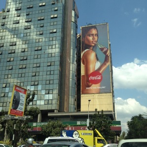 Michelin truck, Coca Cola and more in Nairobi CBD. Street lights when present are often not followed, so in the city and other places you'll often find police directing traffic.