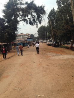 More Kangemi-Sodom. At the Sodom station peoepl at times get hit by traffic. this may have happened on one day as soem of the residents had blocked off one side of the highway and were burning some tree branches in the street in protest.